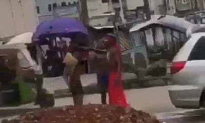 Watch Video As Yahoo Boys Bath On The Road In Umuahia