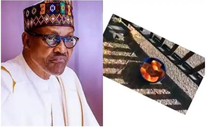 Watch Video As Unknown Person Place Juju In Front Gate Of Abuja House In London